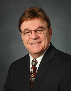 man wearing suit and glasses